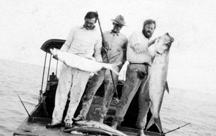 Hemingway, Capt. Bra Saunders, Waldo Peirce with tarpon and kingfish