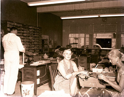 In the front offices of the Key West Citizen building on Greene St., circa 1960.
