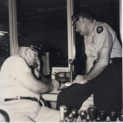 Fire Chief Bum Farto and Capt. Earl Ingraham sitting at the radio desk of the Fire Department in August 1968. Gift Alex Vega, Monroe County Public Library.