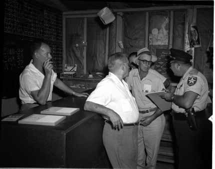 A gambling raid at the Sports Center 513 1/2 Fleming Street C 1960. Wright Langley Collection, Monroe County Public Library.